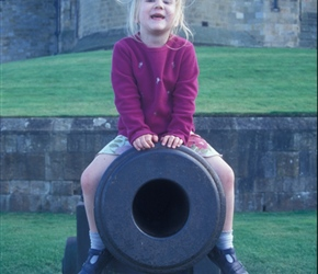 Louise checks out the cannon at Alnwick Castle