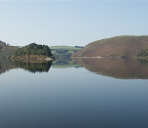 Clywedog Reservoir from the dam. A man made reservoir, the dam was built between 1965-67 to regulate the flow of water in the Severn, both as a protection against flooding of the upper sections of the ri