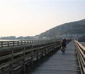 The bridge into Barmouth is shared with the railway line and no cards. It's a bumpy ride over the wooden planks with great water views to the right